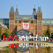 Rijksmuseum with big letters in Amsterdam, Holland (Netherlands) - Stock Photo