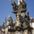 Prague - baroque column of Holy Trinity and tower of st. Vitus cathedral - Photo