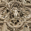 Milan - detail from main bronze gate - Pieta - Stock Photo