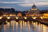 Rome - Angels bridge and St. Peter s basilica in evening — Stock Photo