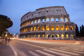 Rome - colosseum in evening and the road — Stock Photo