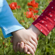 Hands of childre and the meadow — Stockfoto