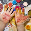 Hands of child by painting — Stock Photo