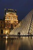 Paris - Louvre pyramid in evening — Stock Photo