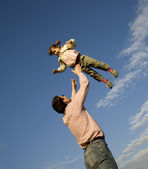 Fun and love of father and child and the sky — Stock Photo