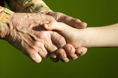 Hands of grandmother and grandchild — Stock Photo