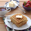 Belgian waffles with maple syrup and butter — Stock Photo