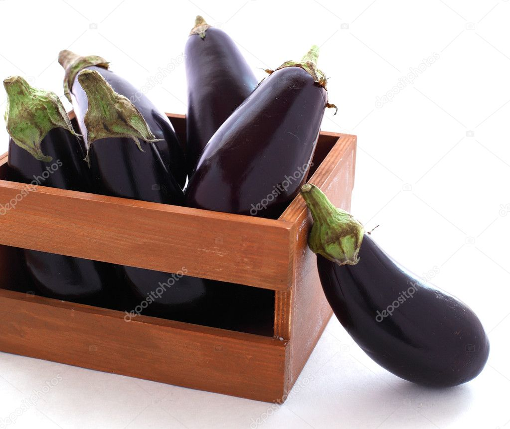 Eggplant in the wooden box on white background — Stock Photo #10476933