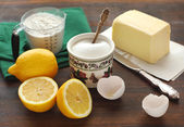 Ingredients for cake - flour, sugar, eggs, butter and lemons — Stock Photo
