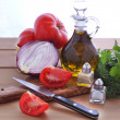 Olive oil, tomatoes, onion and herbs — Stock Photo