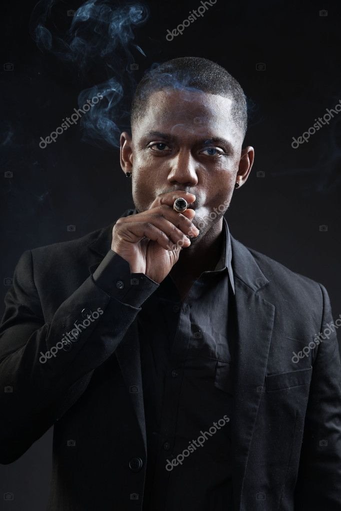 Young black man wearing suit — Stock Photo © ysbrand #10155929