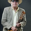 Senior jazz musician with accoustic guitar wearing suit hat and vintage sunglasses. — Stock Photo