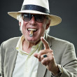 Senior gangster man smoking cigar wearing light suit and hat with vintage sunglasses. — Foto Stock