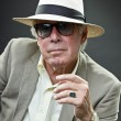 Senior man in suit wearing hat and vintage sunglasses. — Stock Photo