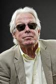 Senior business man wearing light suit and black sunglasses. — Stock Photo