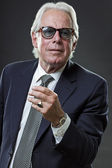 Senior business man wearing blue suit and tie with vintage sunglasses. — Stock Photo