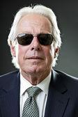 Senior business man with black sunglasses. — Stock Photo