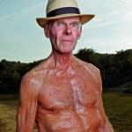 Senior man enjoying nature on beautiful summer day. — Stock Photo #10217137