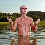 Senior man enjoying nature on beautiful summer day. — Stock Photo