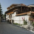 Bansko, famous ski resort in Bulgaria, well known with its old traditional architecture — Stock Photo #10155876