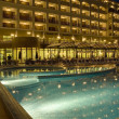 Pool in front of hotel at evening - Stock Photo