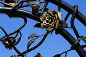 Wrought rose and leaves — Stock Photo