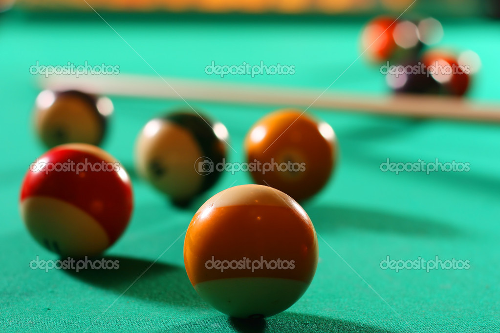 Billiard balls on green broadcloth of the billiard table  Stock Photo #10245150