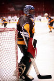 Hockey goalkeeper in generic black equipment — Stock Photo