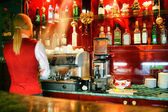 Bar and barman — Stock Photo