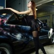 Stock Photo: Girl on background of black car