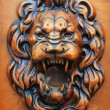 Royalty-Free Stock Photo: Wooden relief of lion