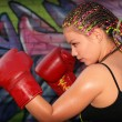 Portrait of a girl with red boxing gloves - Stock Photo