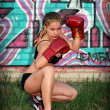 Portrait of a girl with red boxing gloves — Stock Photo #10538069