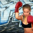 Portrait of a girl with red boxing gloves — Stock Photo #10538080