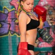 Girl with red boxing gloves — Stock Photo