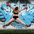 Jumping girl in boxing gloves — Stock Photo #10538282