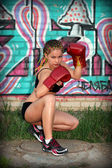 Portrait of a girl with red boxing gloves — Foto Stock