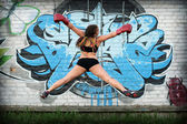Jumping girl in boxing gloves — Stock Photo