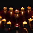 A heart of candles — Stock Photo