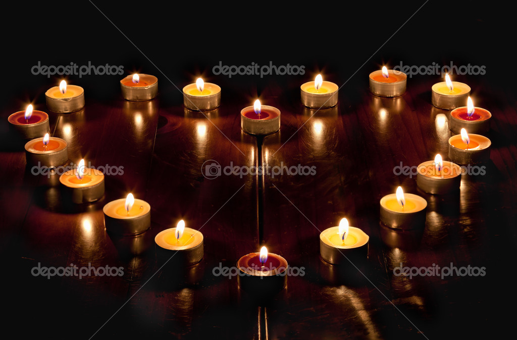 A heart of candles — Stock Photo #10354150