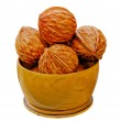 Walnuts from juniper wood in a vase — Stock Photo