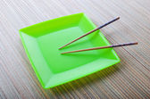 Chopsticks in the plate — Stock Photo