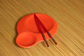 Chopsticks in the round plate — Stock Photo