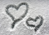 Two hearts on snowy window — Stock Photo