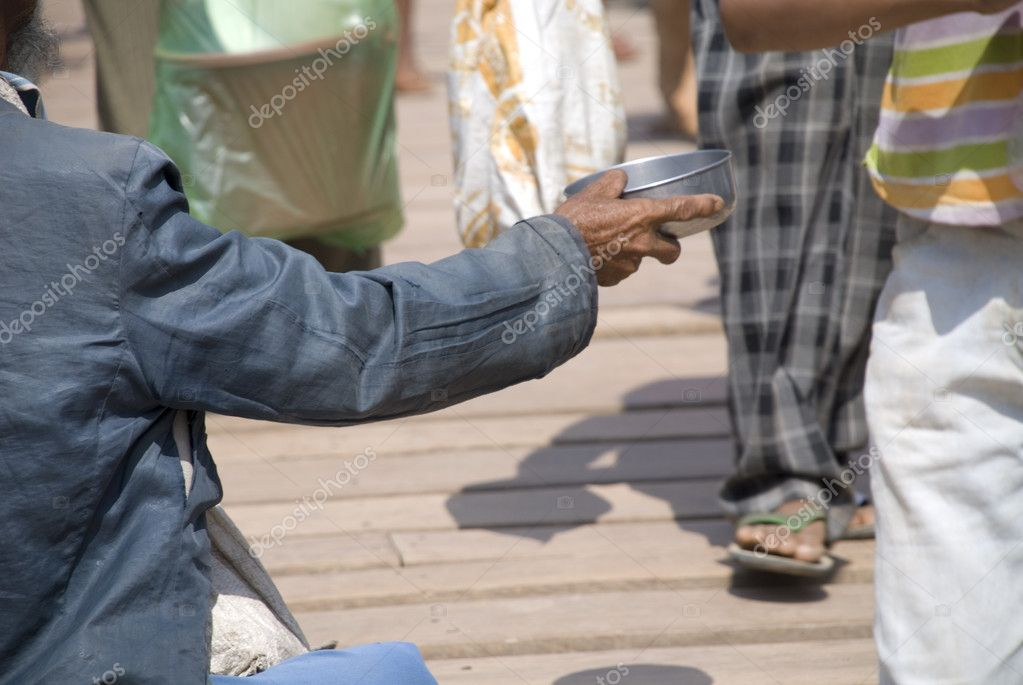 Arm of an elderly Cambodian man sitting down begging on a crossing between Cambodia and Thailand. — Stock Photo #10707965