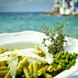 Stock Photo: Pasta with peas and thyme by the beach.