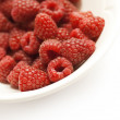 Raspberries in a bowl, white space — Stock Photo