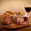 Salami and wine - Stock Photo