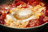 Fried egg with tomato — Stock Photo