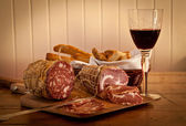 Salami and wine — Stock Photo